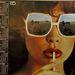 Csák Csilla napszemüvegében a hortobágyi puszta idillje tükröződik - Róna üdítőitalok '85-ből