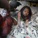 Daniel Morel, Haiti - 2. díj, Vezető hír kategória, egyedi.  Január 12-én, pár perccel a földrengés után egy nőt szabadítanak ki a romok alól Port-au-Prince-ben, Haiti fővárosában. A 7.0 erősségű földrengés epicentruma a fővárostól 15 km-re délnyugatra fekvő Leogane közelében volt.