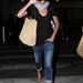 Charlize Theron utálja ha fotózzák, de legalább a papucsa látszik