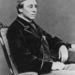 1880. Henry Fawcett brit postaügyi miniszter. Ő vaksága miatt hordott sötét szemüveget.