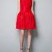 Nyaknál kövekkel díszített piros ruha a Zarában 22995 forint.