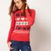 Asos: Szívek és szarvasok, mind visszatérő elem a karácsonyi pulcsikon. Ár: 48,62 euró