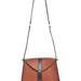 Gondolná, hogy ennek a táskának tervezője sokkoló hajkölteményekkel futott be?