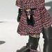 Kosztümmel egyező színű táska a Chaneltől