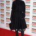 Így érkezett Mirren az Empire Film Awardsra, fekete kabát takarta a virágos ruhát.