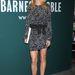 Gwyneth Paltrow immáron modell ellenfele nélkül mosolyog a fal előtt