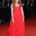 Ismét Isla Fisher: a Nagy Getsby vetítésén és a Cannes-i nyitóesten már egy sokkal puccosabb vörös estélyiben pompázott. Oscar De la Renta műve.