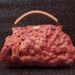 A hússzerű viasz alatt egy Louis Vuitton táska lapul. Andrea Hasler munkája.