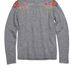 A virágos vállú pulcsi 39900 forint.