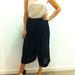 H&M: Ez az összeállítás kicsit Jennifer Lawrence hasvillantós Dior szettjét juttatja eszünkbe. Ár: blúz - 8990 Ft, nadrágszoknya - 9990 Ft