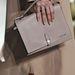 Tejeskávé színű táska a Lacoste kifutóján.
