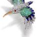Cartier kolibri bross 1941-ből. A 17,66 karátos darab aranyból, briliáns csiszolású gyémántból, smaragdból, zafírból és rubinból készült.