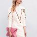 Nanushka nevét a Chanellel, Rag & Bone-al vagy Jil Sanderssel említik egy lapon a Vogue-ban.