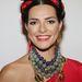 A virágos fejdísz a fesztiválszezon egyik nagy slágere 2013-ban. (A képen Candela Ferro argentin modell érkezik a Miami Hair Beauty and Fashion 2013 by Rocco Donna című eseményre)