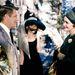 Pauline Trigère öltöztette Patricia Nealt az Álom luxuskivitelben című Blake Edwards filmben 1961-ben.