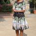 Kedvenc levendulaszínű, virágmintás Tracy Feith ruhájában, melyben már hétszer kapták lencsevégre.