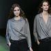 Laza esésű ingek szürke ingek és fekete pantalló Armani kollekciójában.