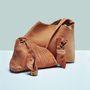 Meg tudná mondani, ez a táska melyik testrészből készült?
