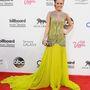 Carrie Underwood ezüsttel szegett neonzöld ruhája nekünk kifejezetten tetszik, de megértjük, ha önnek nem.