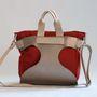 A TWINS táskák valódi bőr tartóból és 2 darab cserélhető textilzsákból állnak.